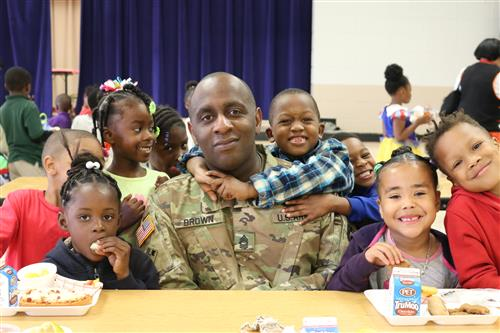 Soldier with smiling children
