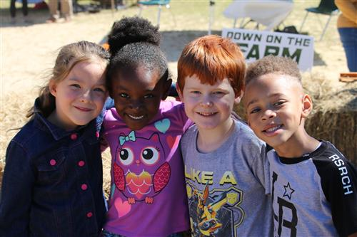 Four Kids Smiling at Field Day