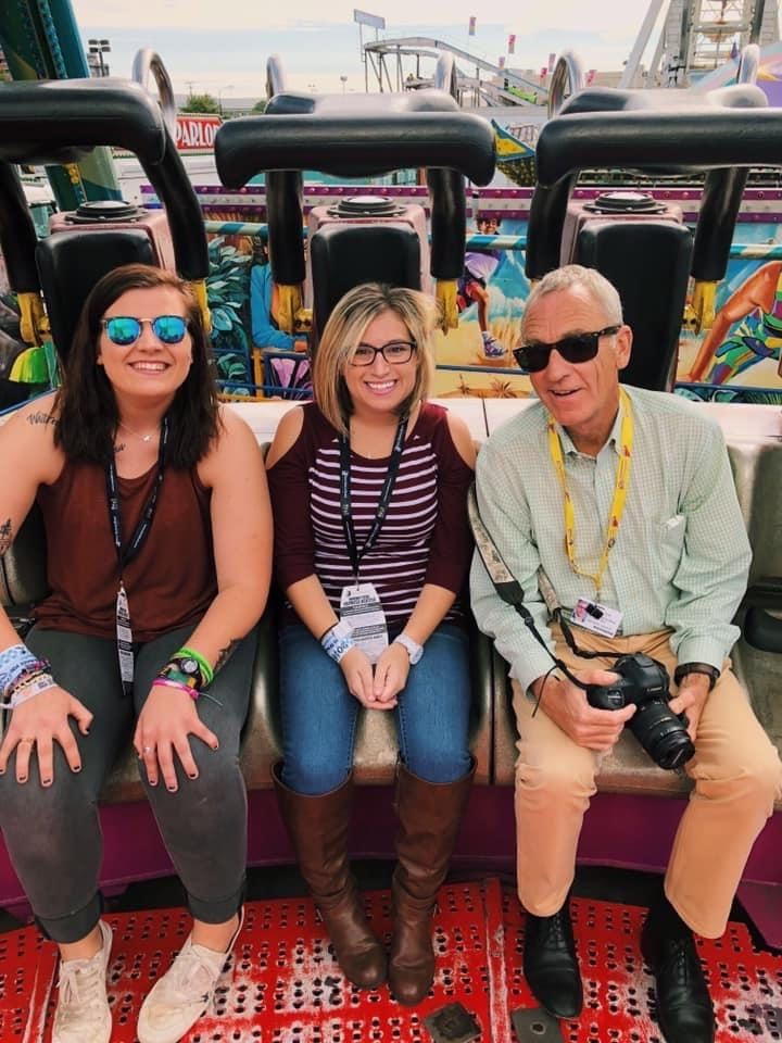 This is me and my friend Kam with our own professional photographer at the South Carolina State Fair. I am in the middle.